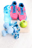 Fitness concept. With dumbbells and green apple - sport and leisure Stock Photos