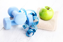 Fitness concept. With dumbbells and green apple - sport and leisure Royalty Free Stock Photo