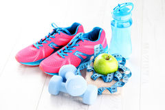 Fitness concept. With dumbbells and green apple - sport and leisure Royalty Free Stock Images