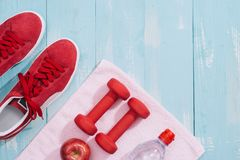Fitness concept with dumbbells and red apple - sport and leisure.  Royalty Free Stock Photo