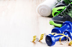 Fitness concept with dumbbells and sneakers Royalty Free Stock Photos