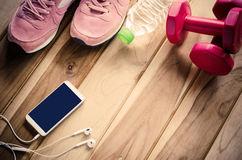 Fitness concept with Exercise Equipment on wooden background Royalty Free Stock Images