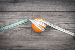 Fitness concept with fruit. Fitness motivation. Fitness concept with fruit and centimeter. Fitness motivation Stock Images