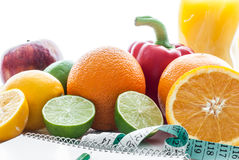 Fitness concept with fruit. Fitness motivation. Fitness concept with fruit. Fitness motivation with centimeter and text book Stock Photos