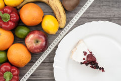 Fitness concept with fruit. Fitness motivation. Fitness concept with fruit vs. plate with cake. Fitness motivation Royalty Free Stock Photos