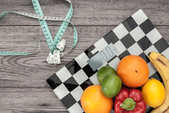 Fitness concept with fruit. Fitness motivation. Weight loss concept. Fitness concept with fruit. Fitness motivation Stock Photos