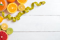 Fitness concept with fruit, a glass of juice and centimeter. Top view background concept. Fitness concept with fruit, bowl of oatmeal and centimeter. Top view Stock Photos