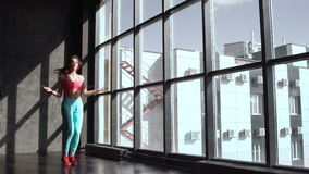 Fitness concept. Healthy lifestyle. Young slim woman jumping with skipping rope in gym. 20s 4k.  stock footage