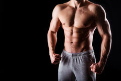 Fitness concept. Muscular and sexy torso of young man having perfect abs, bicep and chest. Male hunk with athletic body. Muscular and sexy torso of young man Royalty Free Stock Photo