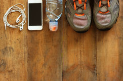 Fitness concept with sport footwear over wooden background. top view image Royalty Free Stock Photo