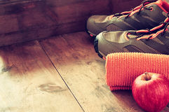 Fitness concept with sport footwear over wooden background. top view image.  Royalty Free Stock Image