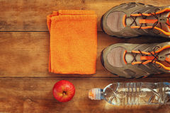 Fitness concept with sport footwear over wooden background. top view image.  Royalty Free Stock Photos