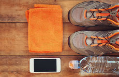 Fitness concept with sport footwear over wooden background. top view image Stock Image