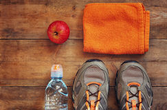 Fitness concept with sport footwear over wooden background. top view image.  Royalty Free Stock Images