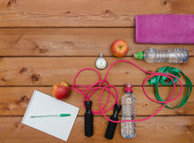 Fitness concept with towel apples stopwatch bottle of water Royalty Free Stock Photos
