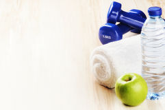 Free Fitness Concept With Dumbbells, Green Apple And Water Bottle Royalty Free Stock Photography - 57079627