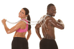 Fitness couple back chain looking Stock Images