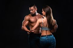 Fitness couple on a black background are in the studio royalty free stock photography