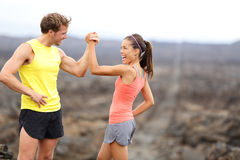 Fitness couple celebrating cheerful and happy. Fitness sport running couple celebrating cheerful and happy giving high five energetic and cheering. Runner couple royalty free stock photos