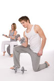 Fitness - couple exercise with metal weights Stock Photography