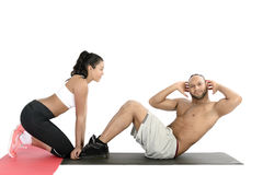 Fitness couple exercising on floor Stock Photography