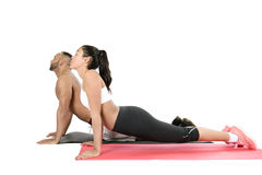 Fitness couple exercising on floor Royalty Free Stock Photography