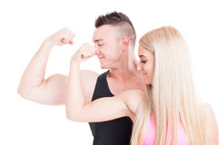 Fitness couple flexing biceps Stock Images