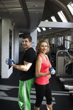Fitness couple with free weight Stock Photography