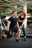 Fitness couple in gym Stock Photography