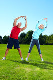 Fitness couple. Happy senior fitness couple in the park Royalty Free Stock Images