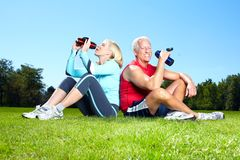 Fitness couple. Happy senior fitness couple in the park royalty free stock photo