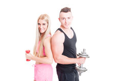 Fitness couple holding weights Stock Photo