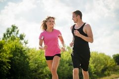 Young couple running together. Fitness concept. Stock Images