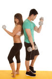 Fitness couple lace bra curls backs. A men and women working out with weights stock images