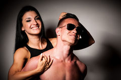 A Fitness couple poses in studio - fit man and woman. Fitness couple poses in studio - fit men and woman stock photo