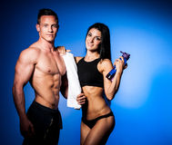 A Fitness couple poses in studio - fit man and woman. Fitness couple poses in studio - fit men and woman royalty free stock image
