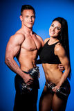 Fitness couple poses in studio - fit man and woman. Fitness couple poses in a studio - fit men and woman royalty free stock image