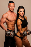 Fitness couple poses in studio - fit man and woman. Fitness couple poses in a studio - fit men and woman stock photography