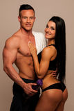 Fitness couple poses in studio - fit man and woman Royalty Free Stock Photo