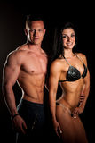 Fitness couple poses in studio - fit man and woman. Fitness couple poses in a studio - fit men and woman stock image