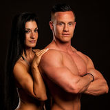 Fitness couple poses in studio - fit man and woman. Fitness couple poses in a studio - fit men and woman royalty free stock images