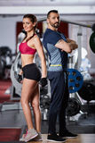 Fitness couple posing in the gym Royalty Free Stock Photo