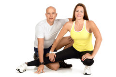 Fitness couple. Posing isolated in white royalty free stock photography
