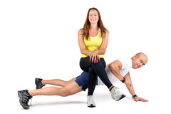 Fitness couple. Posing isolated in white stock photography