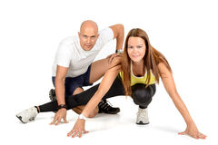 Fitness couple. Posing in white royalty free stock image