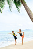 Fitness. Couple Practicing Yoga On Beach. Exercising. Sports. St Stock Image