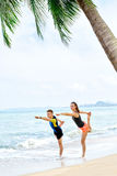 Fitness. Couple Practicing Yoga On Beach. Exercising. Sports. St Stock Photo