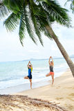 Fitness. Couple Practicing Yoga On Beach. Exercising. Sports. St Stock Photos