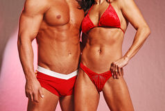 Fitness couple in red Stock Photos
