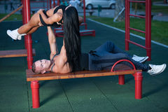 Fitness couple on a street workout Stock Photos